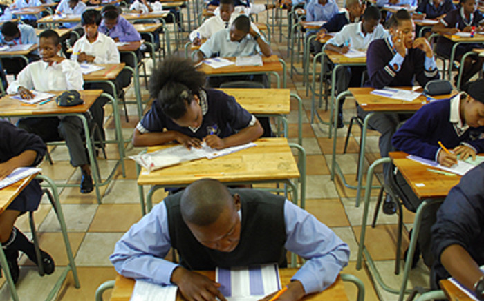 High school pupils writing exams.