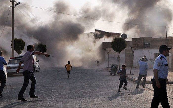 A bomb causes havoc in a Syrian town. Picture: AFP