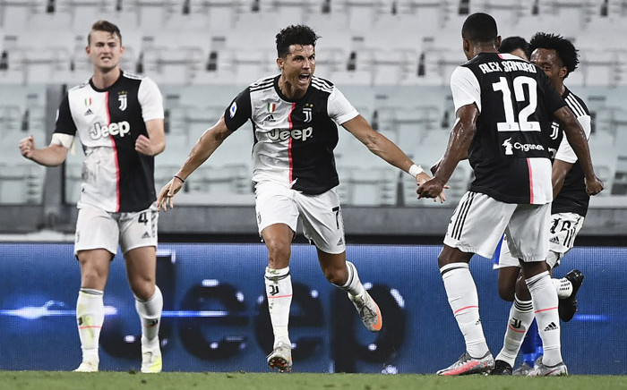 Juventus forward Cristiano Ronaldo (C) celebrates after scoring during the Italian Serie A football match between Juventus and Sampdoria played behind closed doors at the Allianz Stadium in Turin on 26 July 2020. Picture: AFP