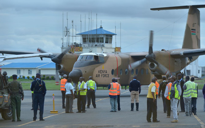 FILE: A military plane transporting the bodies of victims massacred on 2 December, 2014 at Kenya's remote north-eastern town of Mandera, bordering Somalia, arrives at the Wilson airport in Nairobi. Picture: AFP.