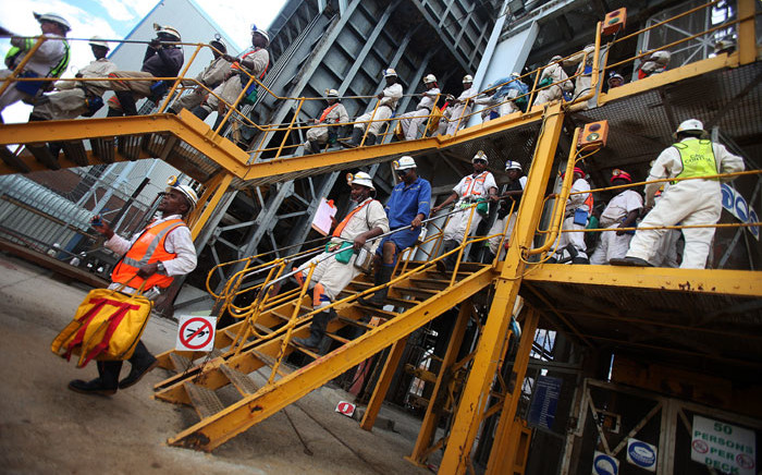 FILE: Mineworkers leave Shaft 14 of the Impala Platinum mine in Phokeng. Picture: AFP.