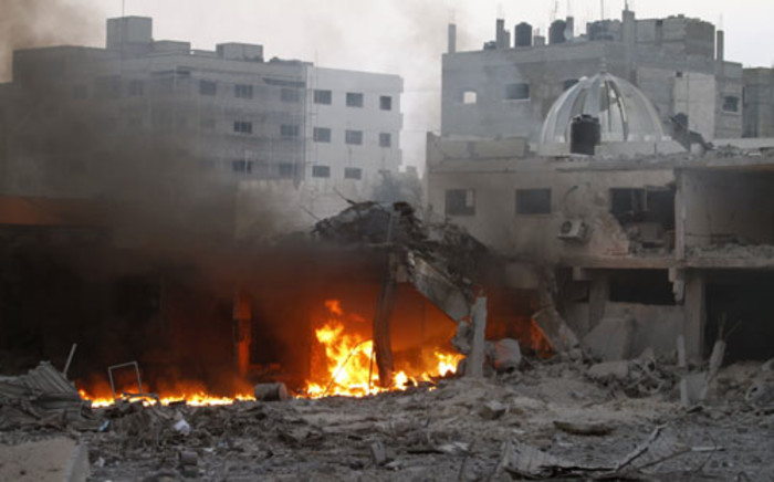 Smoke rises from fire after Israeli air strikes in Gaza City on November 19, 2012. Picture: AFP.