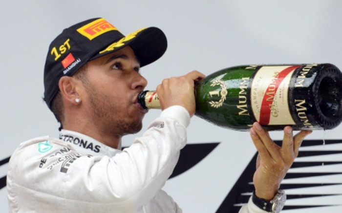 FILE: The Briton Lewis Hamilton who started on pole position, chalked up his fourth win in a row. Picture: AFP.