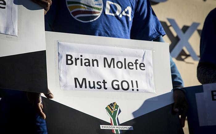 A DA supporter holds a placard during a picket outside Eskom's Megawatt Park offices in Johannesburg on 15 May 2017 against the reappointment of the utility's CEO Brian Molefe. Picture: Reinart Toerien/EWN