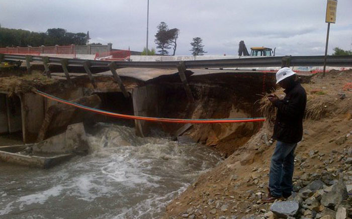 Strandfontein Road closed between Goven Mbeki and New Ottery Road after the roadway collapsed. Picture: Natalie Malgas/EWN.