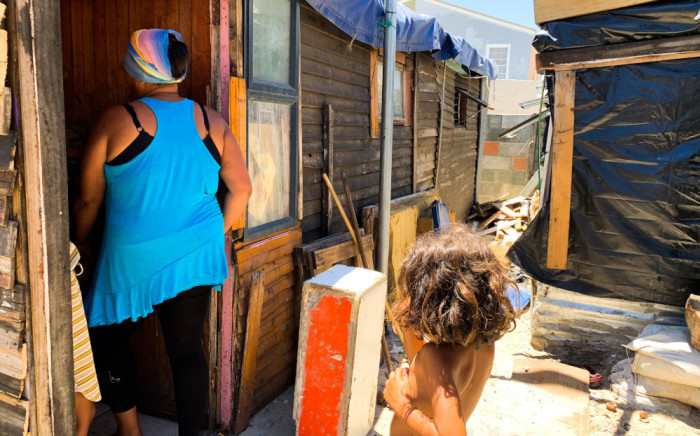 Resident Yolanda Daniels walks into one of the informal structures on the Beacon Valley premises in Mitchells Plain. Picture: Kaylynn Palm/Eyewitness News