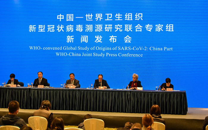 Peter Ben Embarek (3rd-R) and Marion Koopmans (2nd-R) attend a press conference to wrap up a visit by an international team of experts from the World Health Organization (WHO) in the city of Wuhan, in China's Hubei province on 9 February 2021. Picture: Hector Retamal/AFP