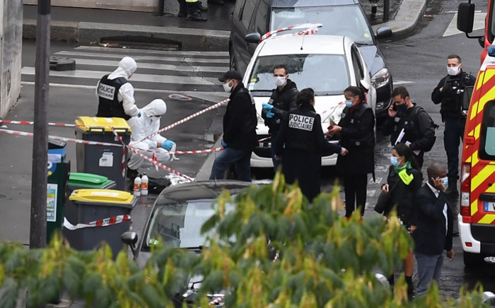 French police and forensic officers inspect the scene of an attack after several people were injured near the former offices of the French satirical magazine 'Charlie Hebdo' by a man wielding a knife in the capital Paris on 25 September 2020. Picture: AFP.