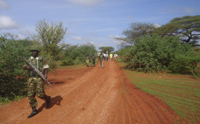 A Kenyan soldier patrols the scene of an attack on a bus, some 30km from Mandera town, north eastern Kenya, on 22 November 2014. Picture: EPA.