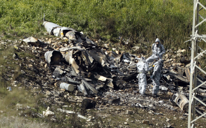 "A picture taken in the northern Israeli Kibbutz of Harduf on 10 February, 2018, shows the remains of an Israel F-16 that crashed after coming under fire by Syrian air defences during attacks against ""Iranian targets"" in the war-torn country. Picture: AFP."