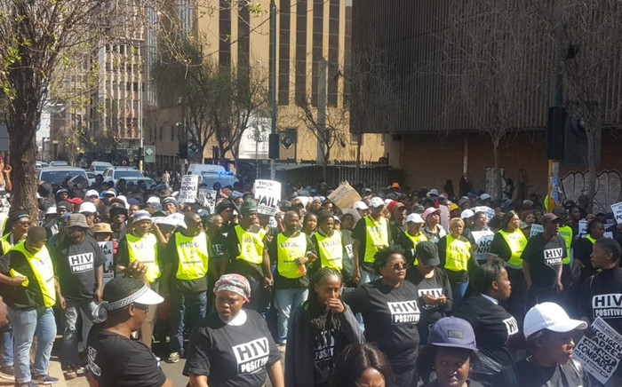 Members of the TAC and Corruption Watch marching outside the Gauteng legislature. Picture: Michael Pedro/EWN