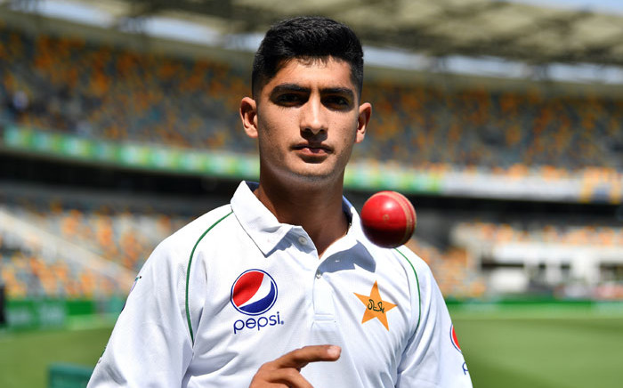 Pakistan's 16-year-old paceman Naseem Shah tosses the ball during a training session at Gabba in Brisbane on 20 November 2019, ahead of the first cricket Test match against Australia. Picture: AFP
