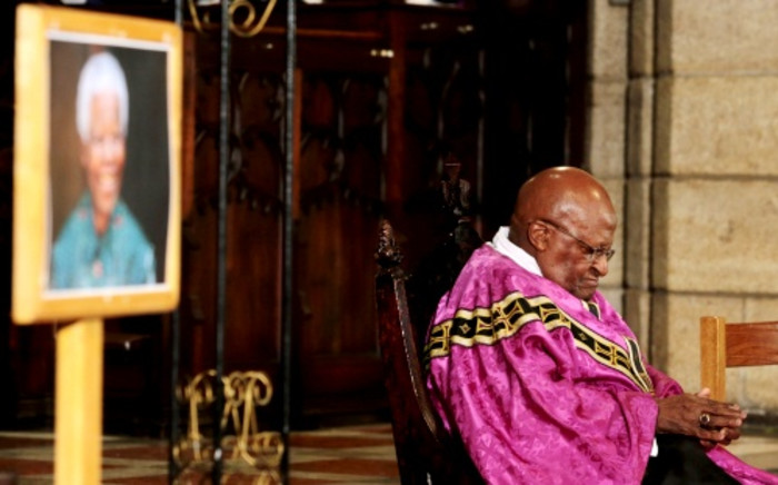 Archbishop Emeritus Desmond Tutu leads a service for the late Nelson Mandela at the St George's Cathedral  in Cape Town, 6 December 2013. Picture: SAPA.