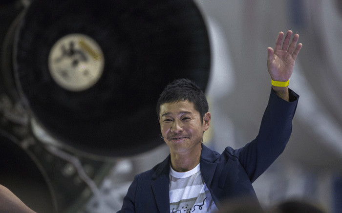 Japanese billionaire Yusaku Maezawa speaks near a Falcon 9 rocket during the announcement by Elon Musk to be the first private passenger who will fly around the Moon aboard the SpaceX BFR launch vehicle, at the SpaceX headquarters and rocket factory on 17 September 2018 in Hawthorne. Picture: AFP