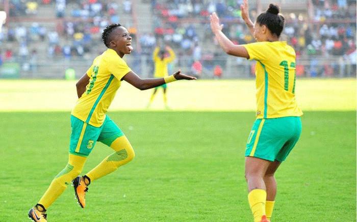 Banyana Banyana's Thembi Kgatlana (L) and Leandra Smeda (R) celebrate after winning the Cosafa Women's Championship against Zimbabwe at the Barbourfields Stadium on 24 September 2017. Picture: safa.net