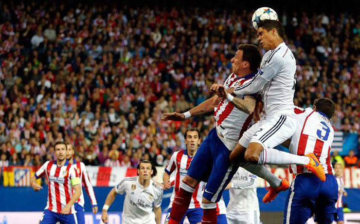 Real Madrid forward James Rodrigues leapss for the ball during the Champions League first leg quarterfinal againts Atletico Madrid on 14 April 2015. Picture: RealMadrid.com