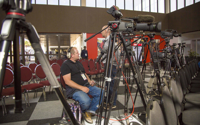 Journalists wait for the first press briefing having already setup at the ANC national conference on 16 December 2017. Picture: Thomas Holder/EWN.