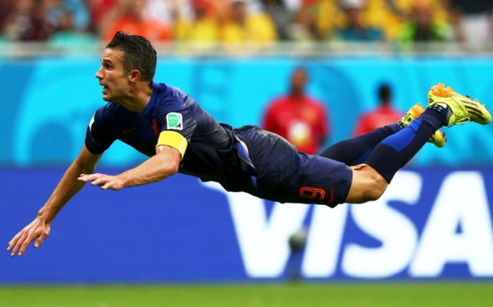 'Flying Dutchman' Robin van Persie of the Netherlands scores the equalising goal with a diving header in the first half during the 2014 FIFA World Cup Brazil Group B match between Spain and Netherlands at Arena Fonte Nova, Salvador, Brazil, 13 June 2014. Picture: Fifa.