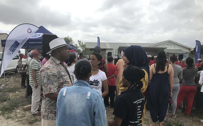 Western Cape Community Safety MEC Dan Plato speaks to residents in Manenberg during a campaign against women and child abuse on 2 December 2017. Picture: Monique Mortlock/EWN