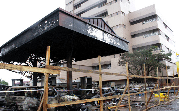 FILE: A picture taken in Accra on 5 June 2015 shows the burnt petrol station where over 150 died on June 3 as a result of fire and heavy flooding. More than 150 people died in a devastating petrol station blast during heavy flooding in Ghana's capital. Picture: AFP.