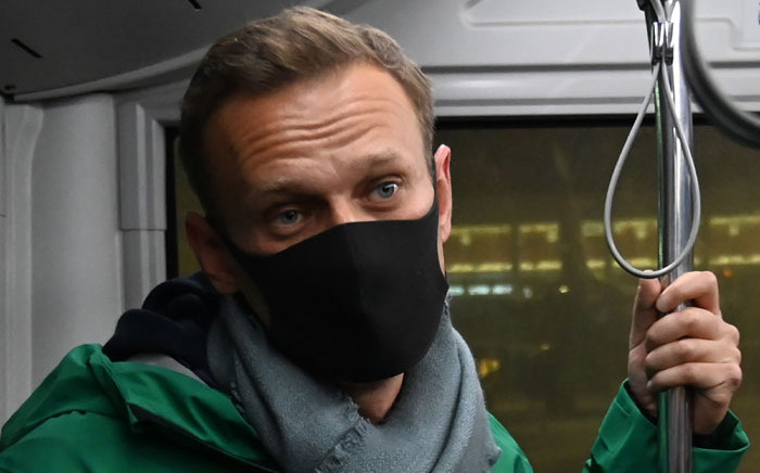 Russian opposition leader Alexei Navalny rides on a bus from a plane to a terminal of Moscow's Sheremetyevo airport on 17 January 2021. Picture: AFP