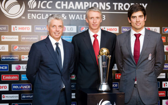 ICC Chief Exectuive David Richardson (L), tournament director Steve Elworthy (C) and England cricket captain Alistair Cook pose at the launch of the 2013 ICC Champions Trophy in London. Picture: AFP