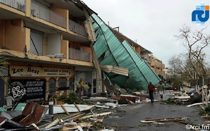 This handout picture released on 7 September 2017 by RCI.fm shows damages on the French overseas island of Saint-Martin after high winds from Hurricane Irma hit the island. Picture: AFP.