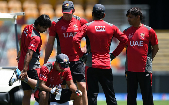 Teammate Khurram Shahzad (L) and support staff stand around United Arab Emirates (UAE) captain Mohammad Tauqir (2nd L) during a break in training ahead of 2015 Cricket World Cup Pool B match between Ireland and UAE at the Gabba cricket stadium in Brisbane on 24 February, 2015. Picture: AFP