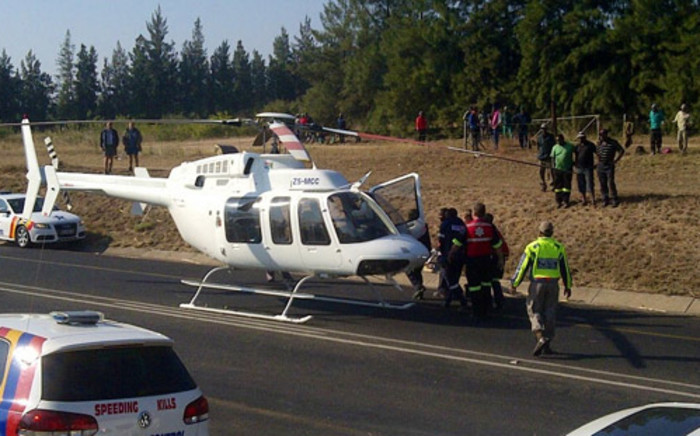 Rescue personnel load a patient into a helicopter after a train & truck accident in Mpumalanga on 13 July 2012. Picture: ER24