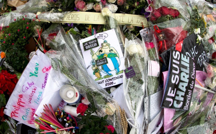 Tributes laid outside the offices of French satirical magazine Charlie Hebdo in Paris on 14 January 2014. Picture: AFP.