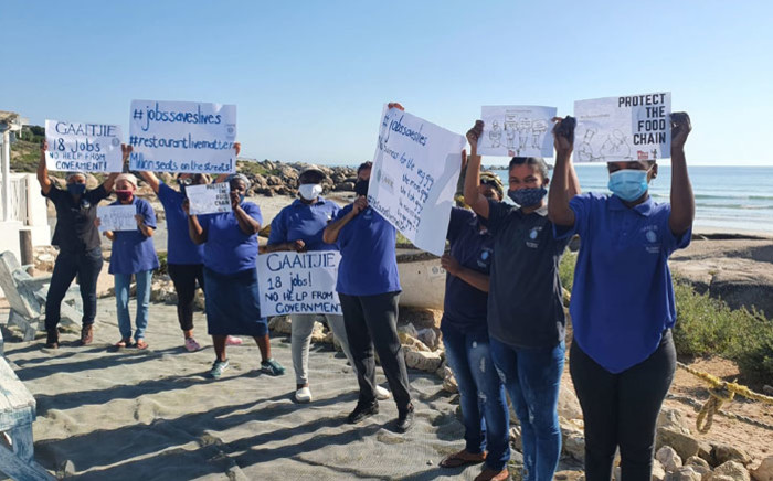 Employees at Gaaitjie restaurant in Paternoster on the West Coast protest for the relaxation of lockdown restrictions on 22 July 2020.Picture: Supplied