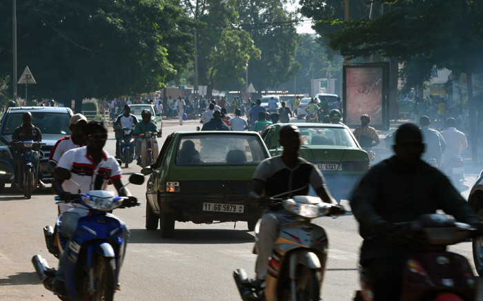 Vehicles run in a street of Ouagadougou in Burkina Faso, on 21 September, 2015. Picture: AFP.