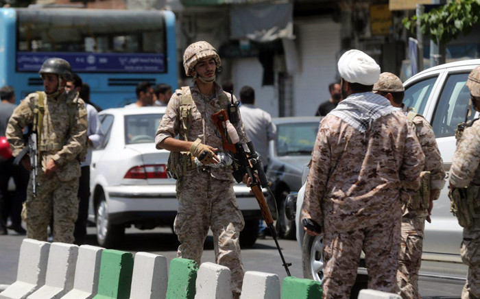 File: Members of the Iranian Revolutionary Guard secure the area outside the Iranian parliament. Picture: AFP.
