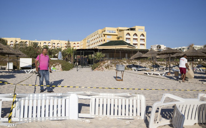 A member of the Tunisian security forces patrols the beach of the Riu Imperial Marhaba Hotel on the outskirts of Sousse south of the capital Tunis on 27 June 2015 in the aftermath of a shooting attack on the beach resort claimed by the Islamic State group. Picture: AFP.