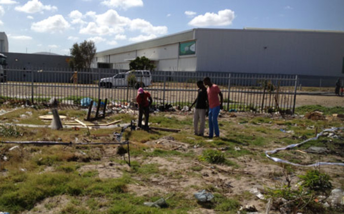 People invade a piece of land which belongs to Old Mutual in Marconi Beam near Milnerton. Picture: Regan Thaw/EWN