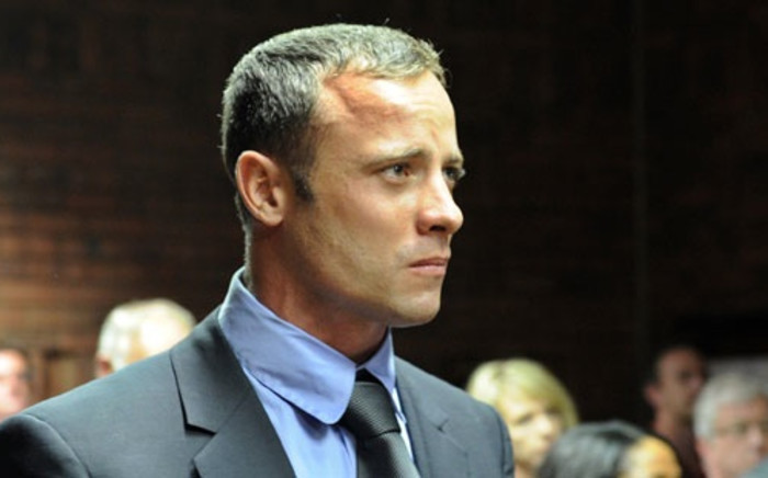 FILE: Oscar Pistorius in court on charges of murdering his model girlfriend, Reeva Steenkamp. Picture: AFP.