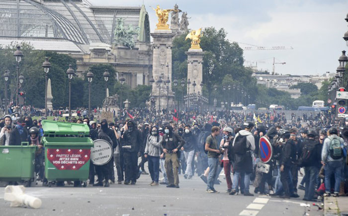 Protesters gather during a demonstration against proposed labour reforms near the Grand Palais, in Paris on June 14, 2016. Twenty-six people were hurt and authorities made 15 arrests as protests in Paris over disputed labour reforms descended into violent clashes between riot police and masked troublemakers. Picture: AFP.