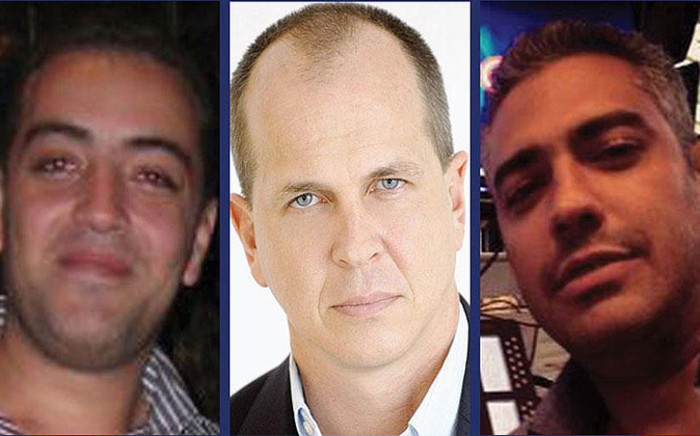 FILE: Al Jazeera staff (L-R) Baher Mohamed, Peter Greste and Mohamed Fahmy were sentenced to seven years in an Egyptian Court on 23 June 2014.