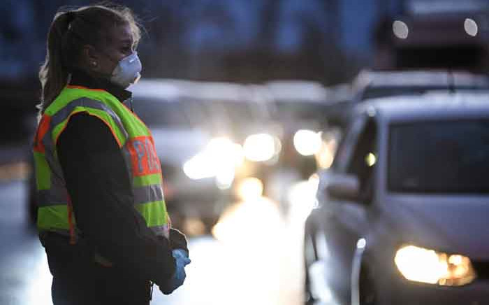 FILE: A German police officer wearing a facemask controls drivers at the French and German border between the cities of Strasbourg and Kehl on 12 March 2020 as part of measures taken due to the COVID-19 outbreak in Europe. Picture: AFP.
