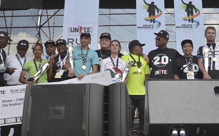 Minister of Sport & Recreation, Mr Fikile Mbalula and Minister of Arts & Culture, Mr Nathi Mthethwa celebrate the victory moment with the winners of the Nelson Mandela Sport and Culture Day in Pretoria on 22 November 2014. Picture:Supplied
