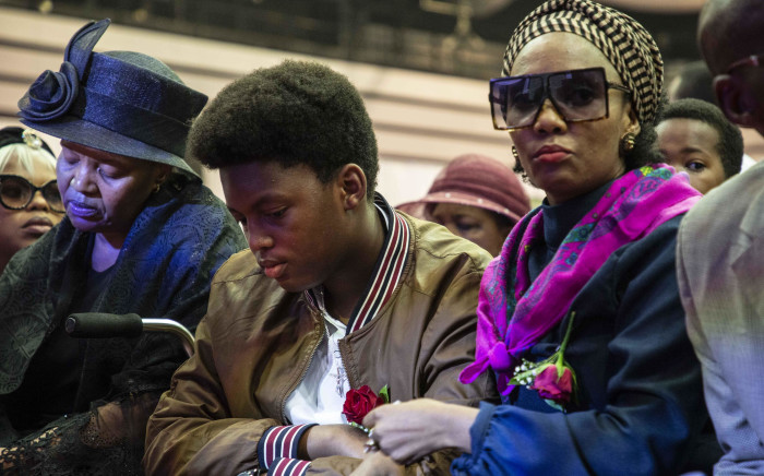 """The Tsambo family and HHP's son at Jabulani """"HHP"""" Tsambo's funeral in Mmbatho Convention Centre in the North West. Picture: Abigail Javier/EWN."""