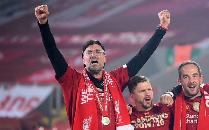 Liverpool manager Jurgen Klopp (left) celebrates during the Premier League trophy presentation following the English Premier League football match between Liverpool and Chelsea at Anfield in Liverpool, north west England on 22 July 2020. Picture: AFP