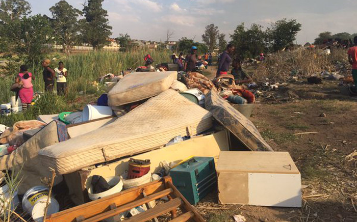 Residents have started moving their belongings into the shacks that weren't ravaged in the Msawawa informal settlement fire. Picture: Emily Corke/EWN.