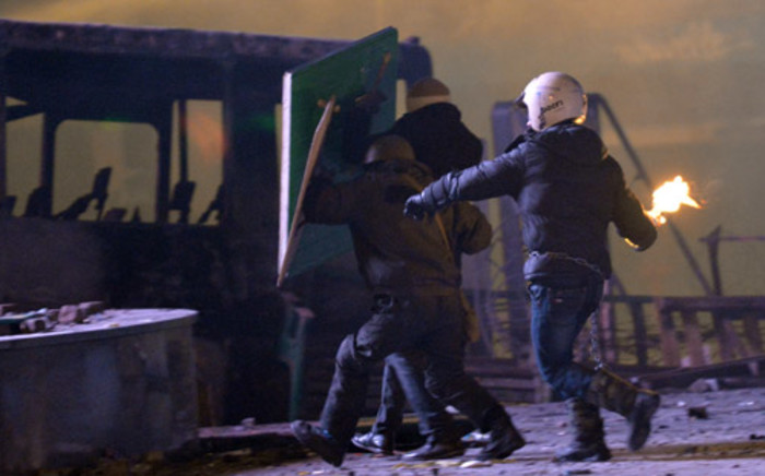 A protester throws a Molotov cocktail during clash with the police in the centre of the Ukrainian capital Kiev on 20 January, 2014, after 200,000 turned up for an opposition rally in a show of defiance against strict new curbs on protests. Picture: AFP