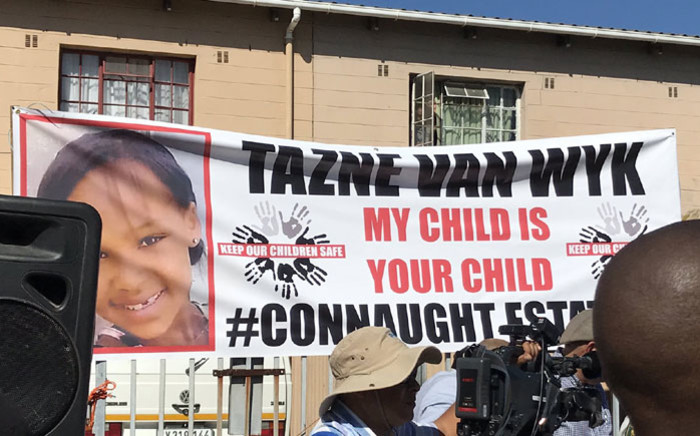 A banner outside a house in Connaught Estate where President Cyril Ramaphosa visited the family of murdered Tazne van Wyk on 26 February 2020. Picture: Kevin Brandt/EWN