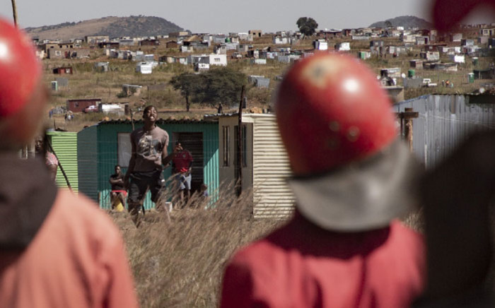 The Red Ants (foreground) confront residents of the Lakeview informal settlement near Ennerdale on 21 April 2020 after they were evicted by by the City of Joburg. Picture: Sethembiso Zulu/EWN