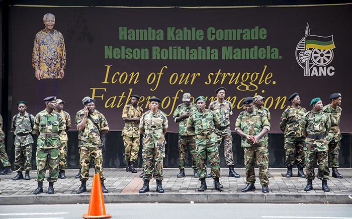 Scores of ANC MKMVA members stand guard outside Chief Albert Luthuli House in Johannesburg's CBD in a show of solidarity with President Jacob Zuma as marches against the president carry on across the country on 7 April 2017. Picture: Reinart Toerien/EWN.