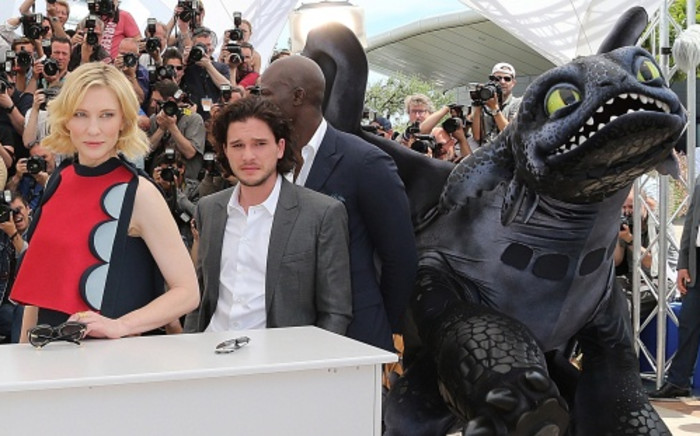 Cate Blanchett, Kit Harington and Djimon Hounsou pose with an inflatable dragon at the Cannes Film Festival on 16 May. Picture: AFP.