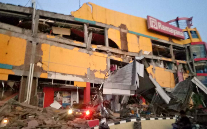 This handout photograph taken and released on 28 September 2018 by Indonesia's National Agency for Disaster Management (BNPB) shows a collapsed shopping mall in Palu, Central Sulawesi, after a strong earthquake hit the area. Picture: AFP