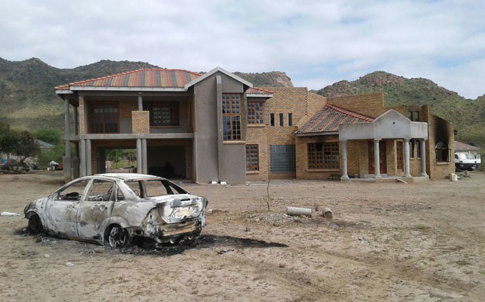A car that was set alight during a mob attack in Limpopo. Picture: Supplied.
